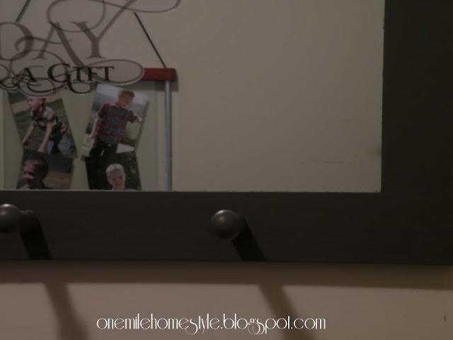 Dark gray wall mirror detail
