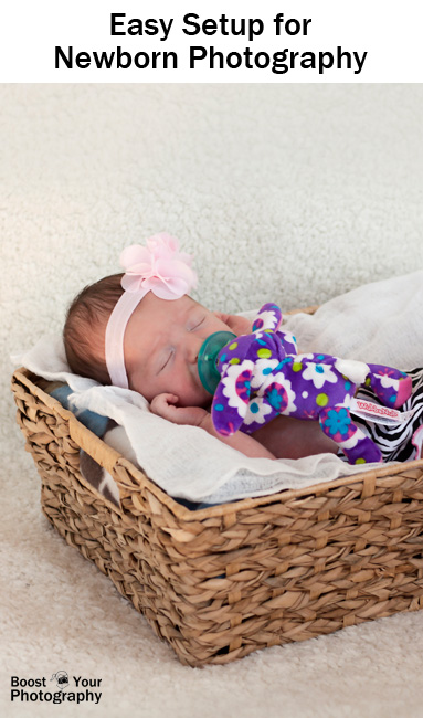 Pillows and additional blankets were placed on top of the coffee table and underneath the backdrop when photographing the baby without the basket