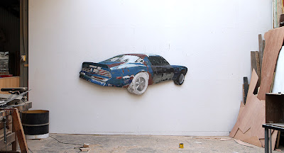 Ron van der Ende Phoenix: Rise ! (Pontiac Firebird Trans-Am) 2011 bas-relief in salvaged wood 260cm x 95cm x 18cm