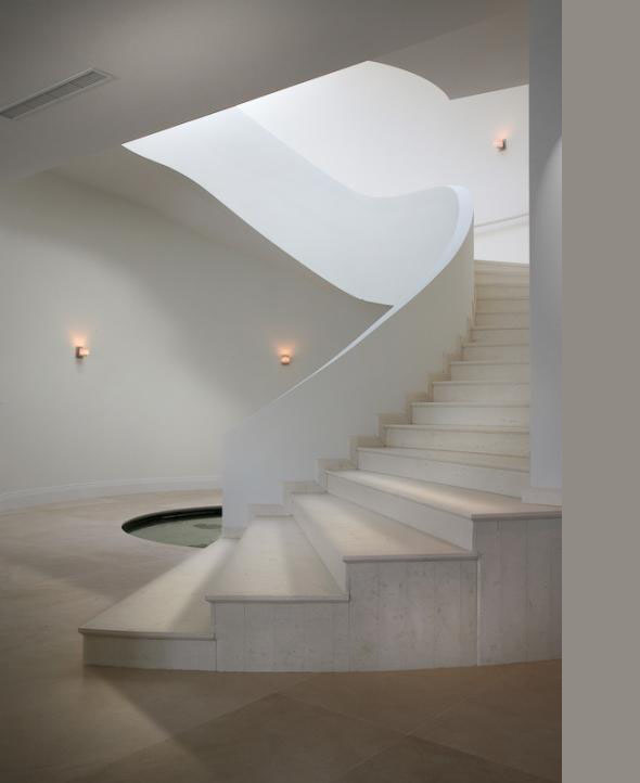 Concrete minimal staircase in the Modern Villa by Touzet Studio