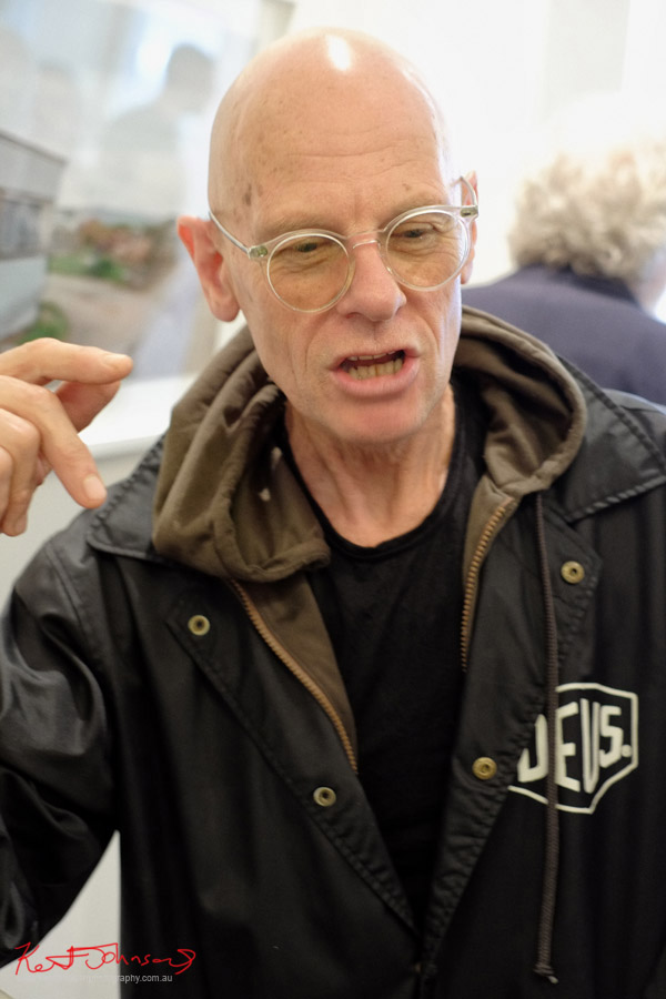 DEUS jacket black Tee and Hoodie, clear glasses frames - Adrian in conversation, Chris Round exhibition, ARTHERE.