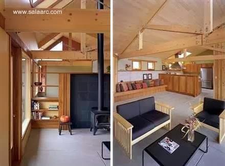 Interior de la casa principal con postes y vigas de madera