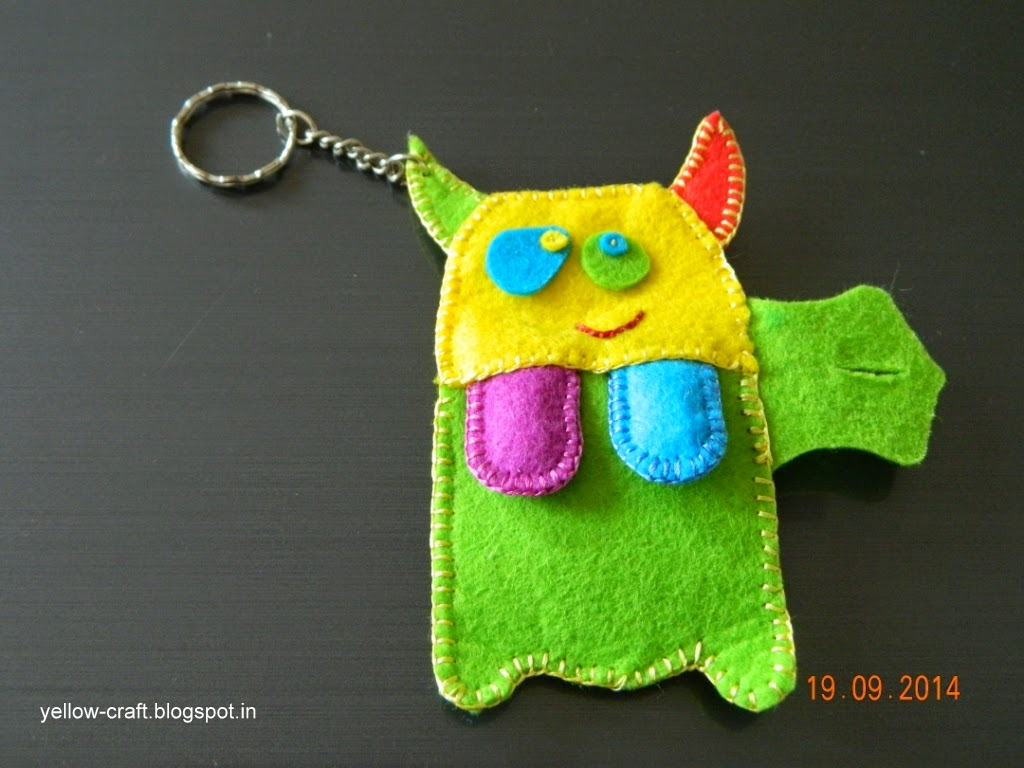 Here is cute monster – key chain and earphone holder ready for use.