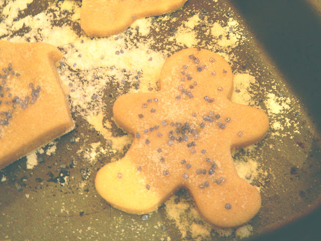 Cookie dough cut into a gingerbread man shape