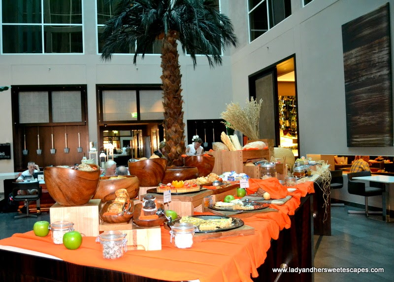 a table of pastries, bread and cheese at the BubblOrange Brunch