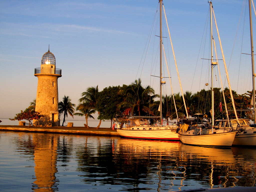 Sunrise reflection off the Boca Chita Lighthouse with Island Packet Yachts