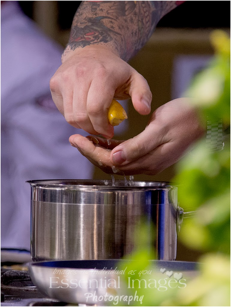 Squeezing lemon through fingers in cookery demo
