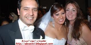 صورة زفاف انجي شرف وزوجها