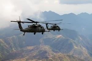 Ilustrasi penerbangan helikopter di atas gunung (Thinkstock)