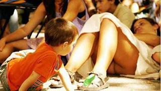 funny image: child sneak peeks under the skirt