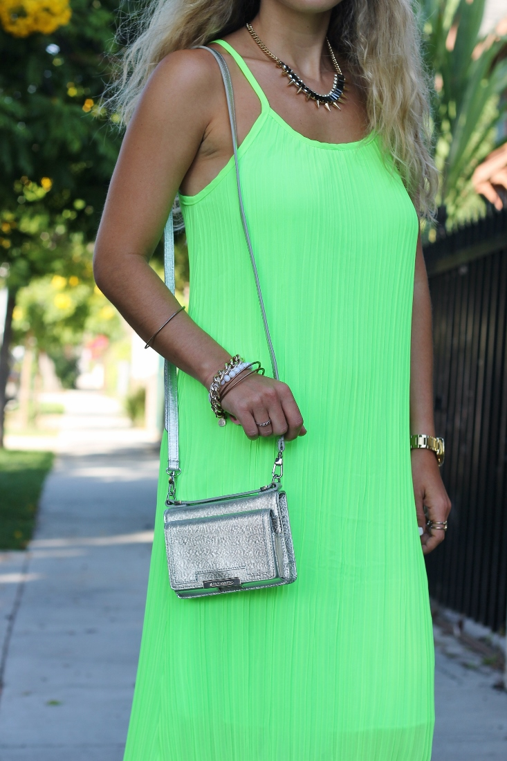 Silver cross body bag with neon dress