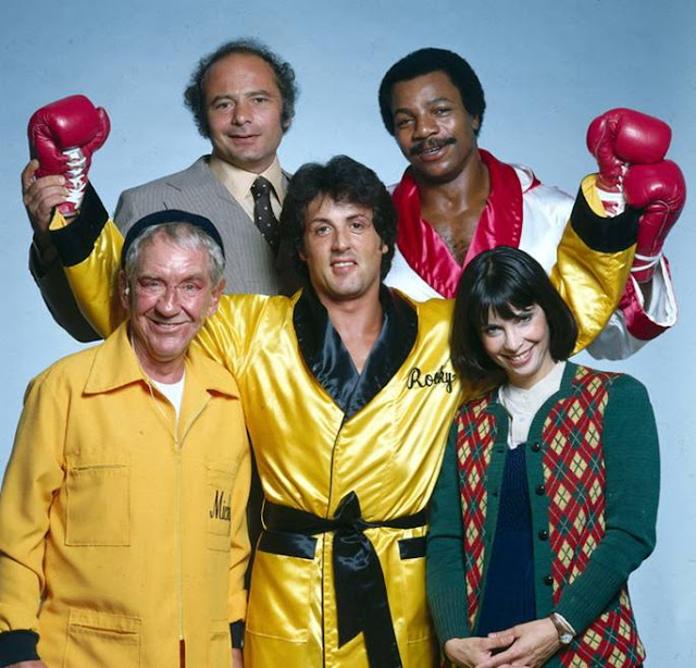 Sylvester Stallone with the crew of Rocky II, 1978