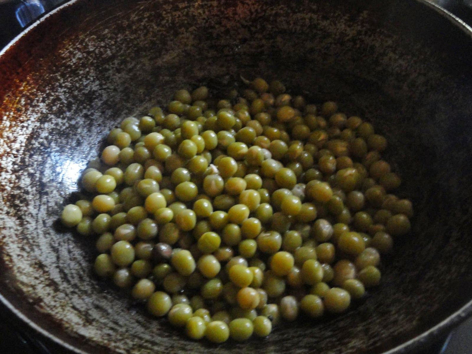 Peas added to coconut mixture