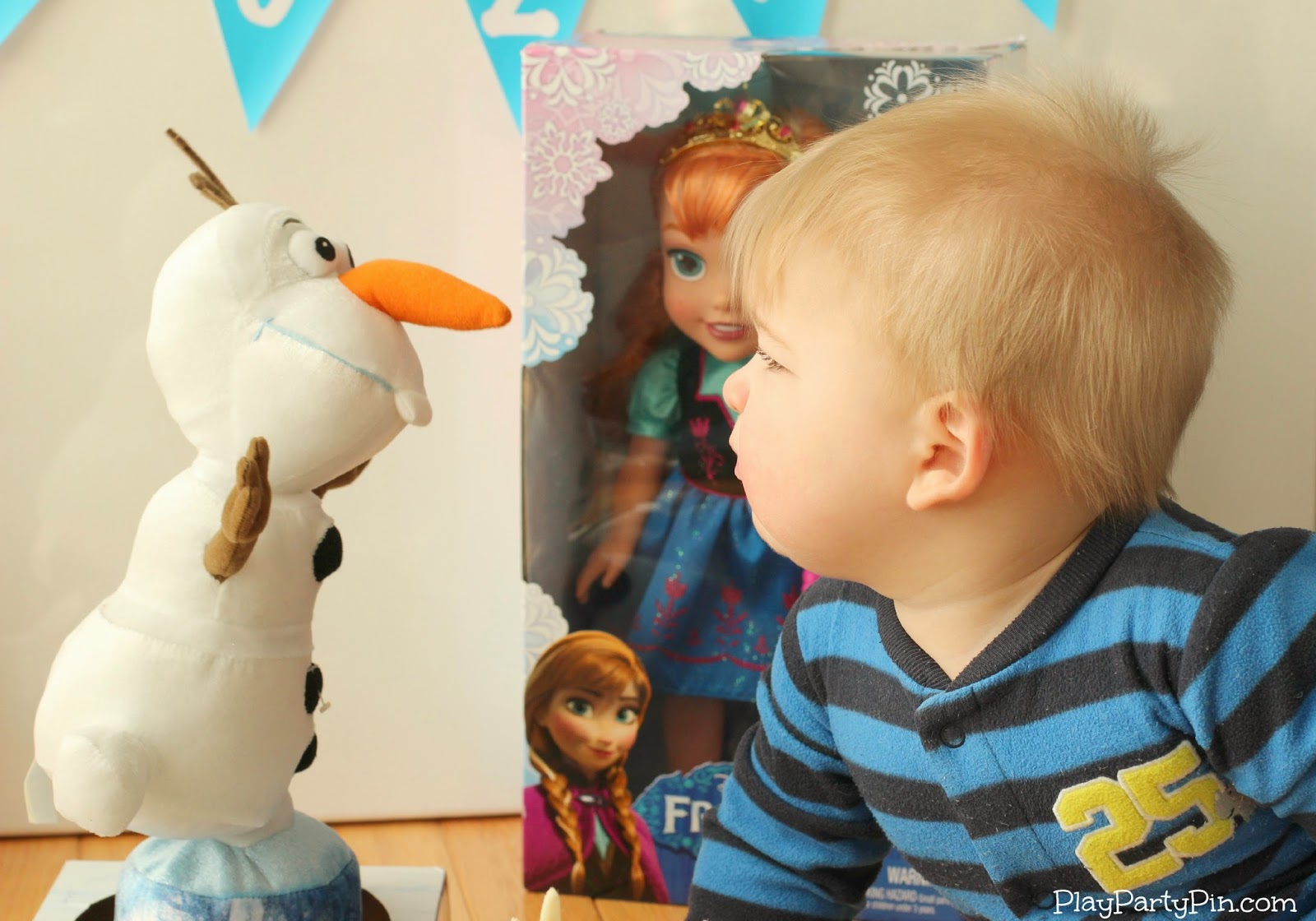Spinning Olaf Toy with Baby