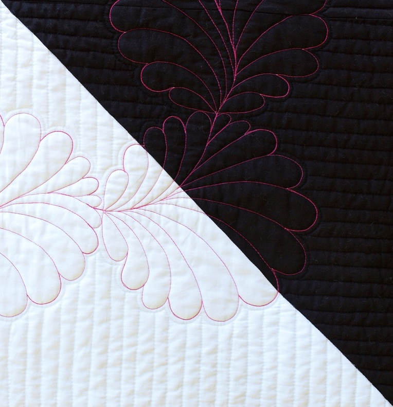 pink feather quilt wall -#main