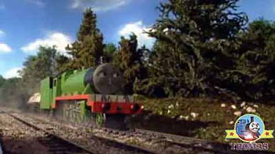 Henry the green steam train loved the beautiful lakeside Scottish castle grounds spruce pine tree