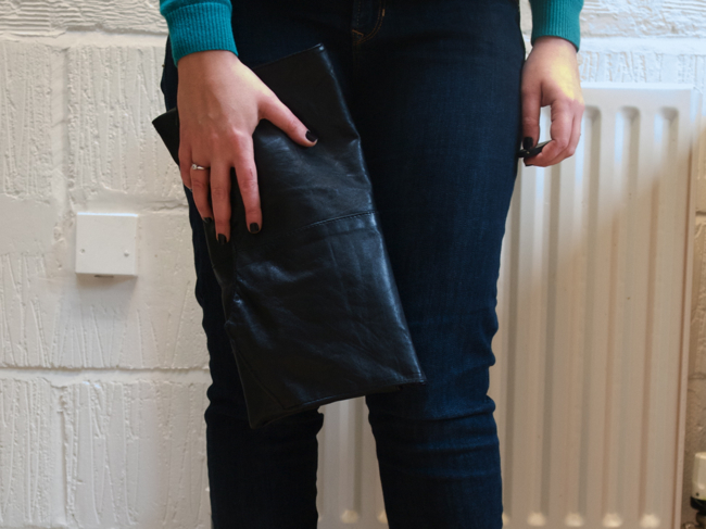 Detail turn a black vintage leather waistcoat into a black DIY clutch bag