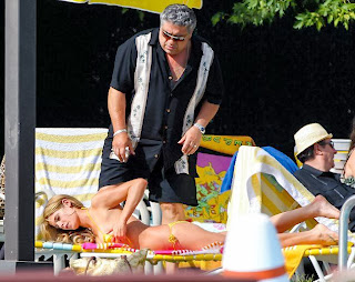 Then directly, her father, Vincent Pastore looked an overprotective on the shot scenes by the poolside.