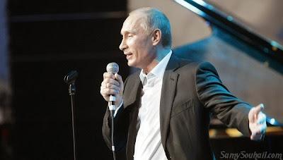 فلاديمير بوتين الرئيس الروسي يغني في برنامج The Voice بالفيديو