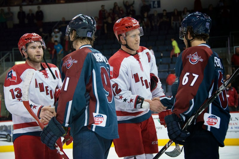 Gary Steffes and Chad Costello shake hands with Tulsa players at the conclusion of their 1st round series. Photo courtesy: SceneByKimberly