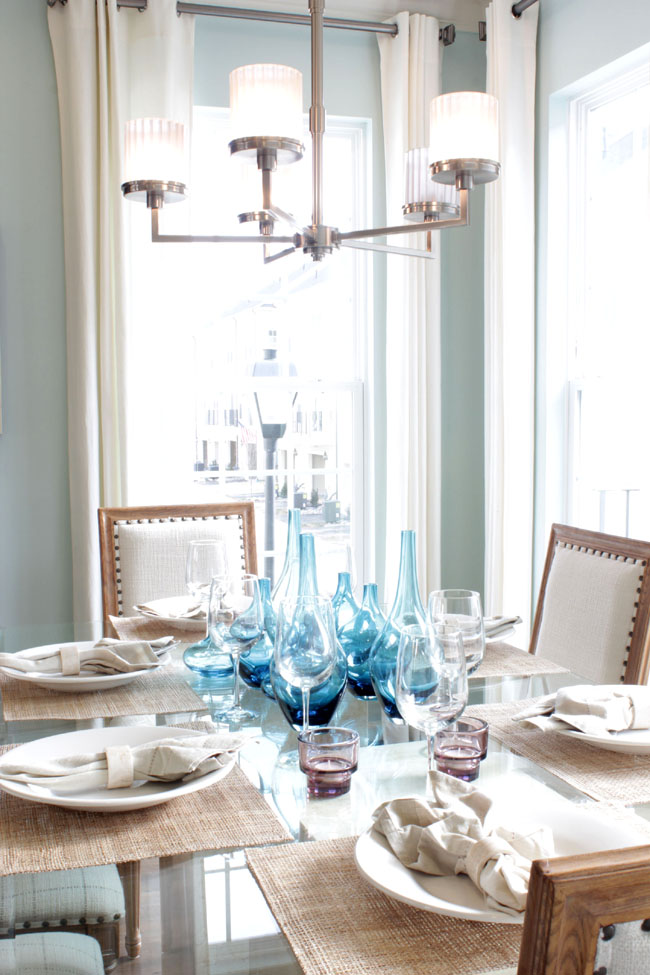 light blue and white dining room in townhouse home tour at Gallery Park