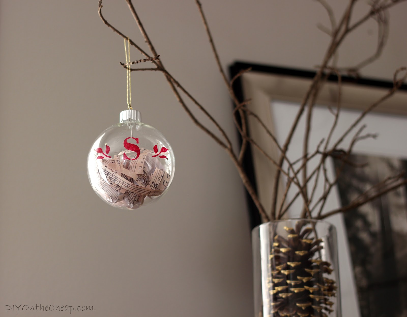 Monogrammed glass ornament filled with sheet music