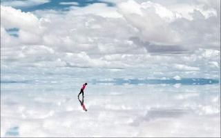 Image of person standing on salar de uyuni