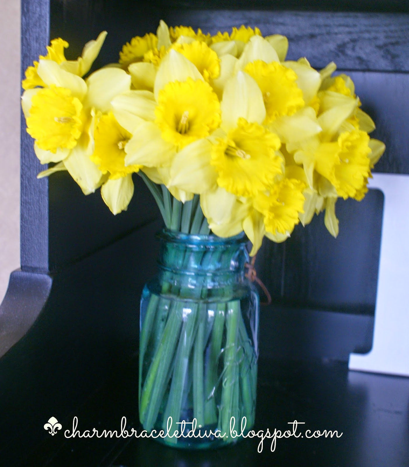 daffodils in blue mason jar