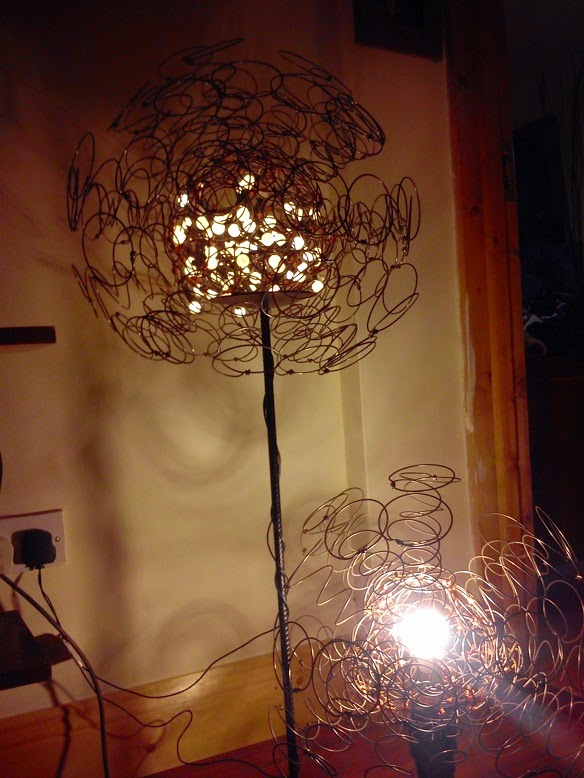 The art of up cycling upcycled mattress springs creates funky copper wire mattress springs christmas fairy lights old lampshade stand greentooth Image collections