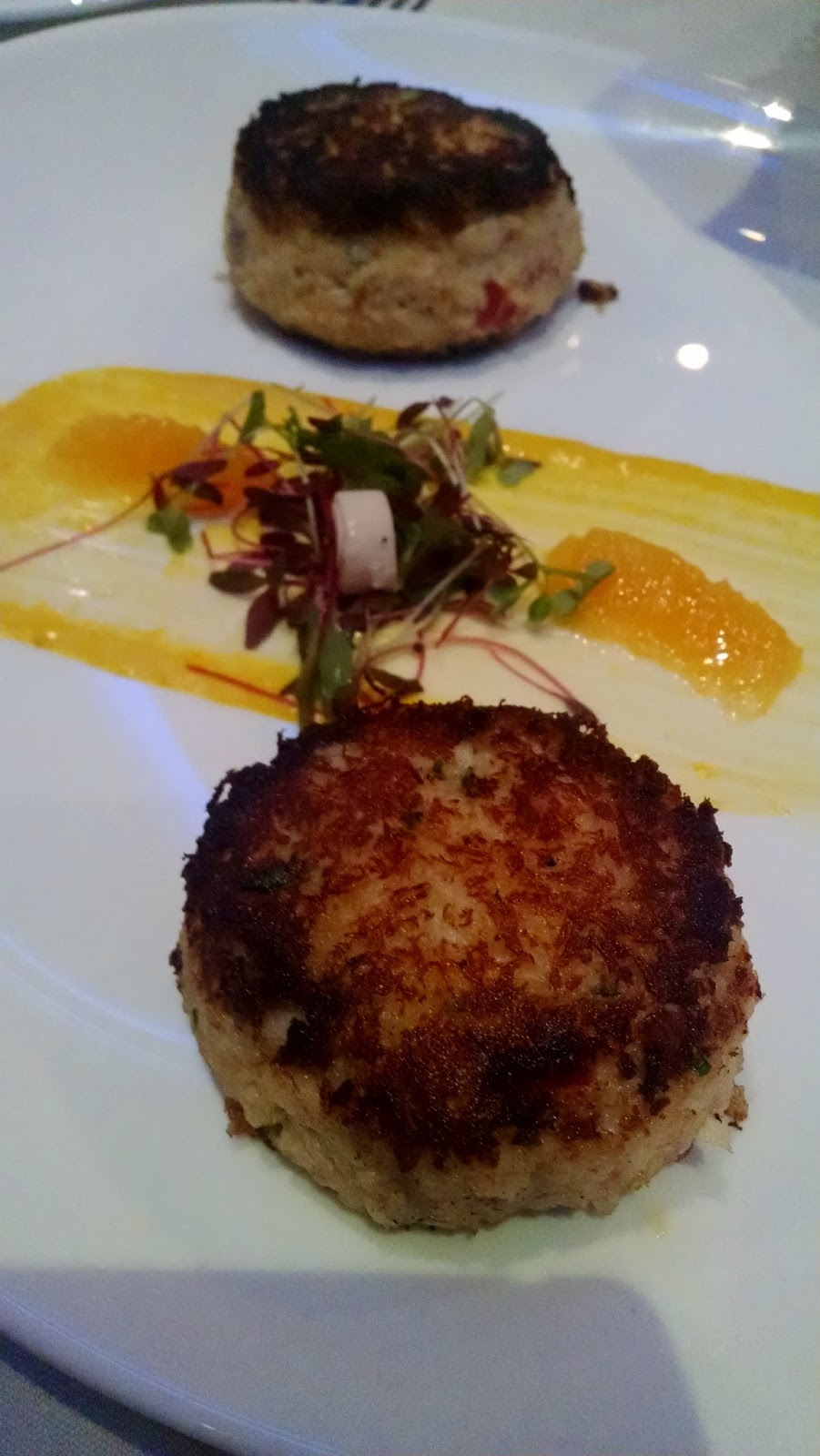 ... Crab cakes with yellow pepper remoulade, orange and hearts of palm