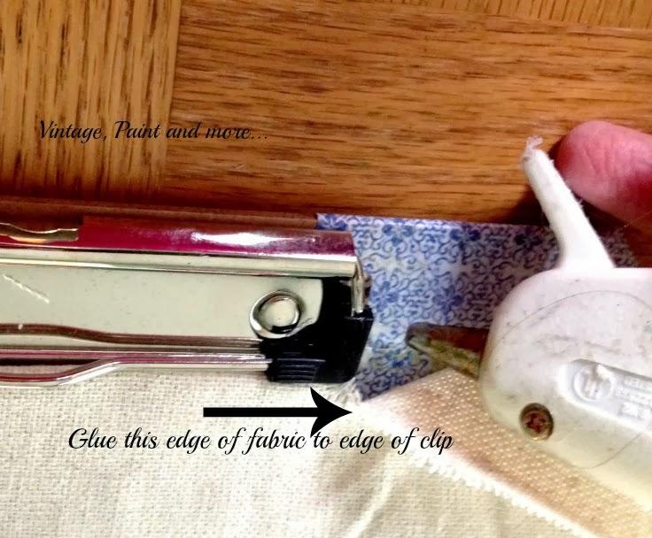 Stenciled Clip Boards - image of gluing edge of fabric to side of clip of clip board