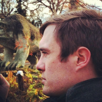 A man and a dinosaur
