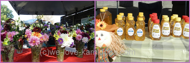 Table full of flowers in vases and lots of honey for sale