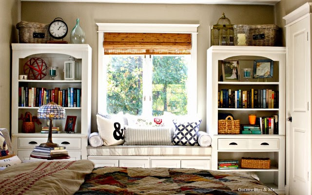 Bookshelves and built in window seat in master bedroom via www.goldenboysandme.com
