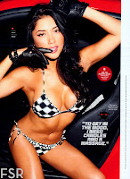Arianny Celeste in black and white bikini sitting in the car