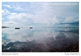 basin sailing boats calm reflection Scotland Scottish landscape Angus East Coast clouds blue pebbles