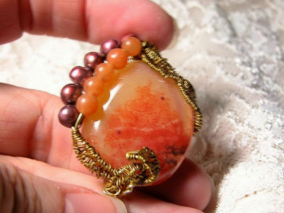 http://customgemcutter.weebly.com/wire-work-pendants.html