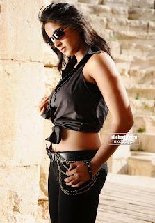 Thigh Show Pretty Anushka in black dress Stills