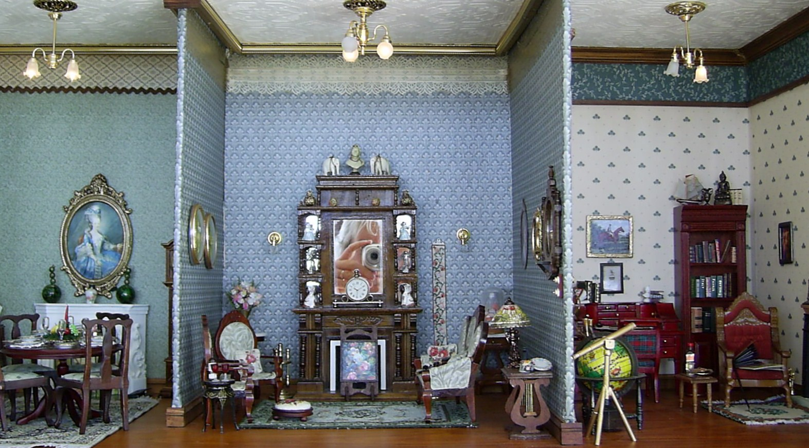 Dining room, living room and study of the Edwardian dolls house title=