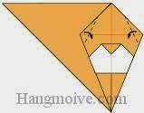 Bước 9: Gấp chéo hai cạnh giấy vào trong.