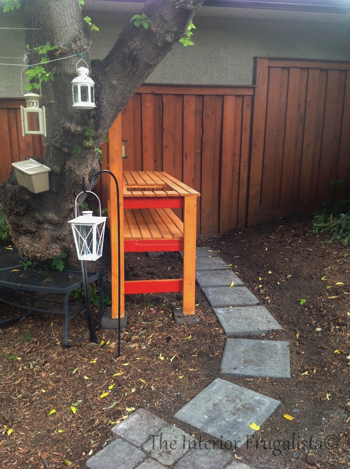 Easy DIY potting bench and outdoor bar with lanterns