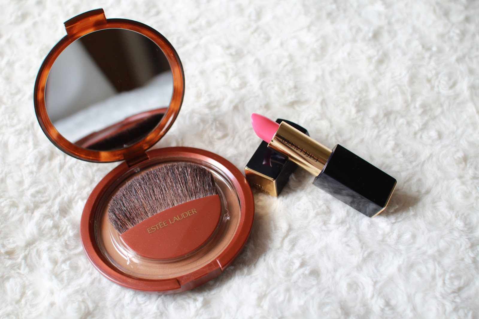 Estee lauder bronze goddess powder and pure color envy in ambitious pink