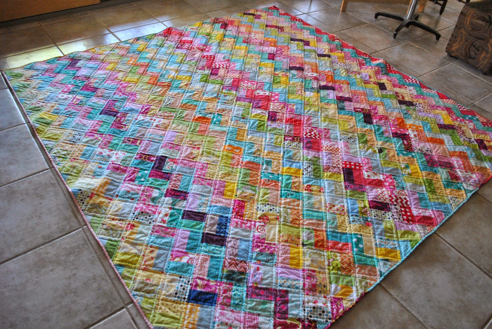 scrappy chevron quilt floor