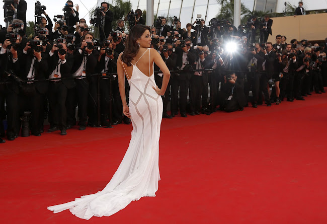 EVA LONGORIA on the red carpet in a glamorous white dress at Cannes Film Festival 2012