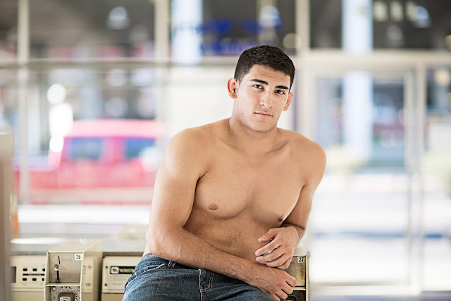Hunky model sits in casual setting