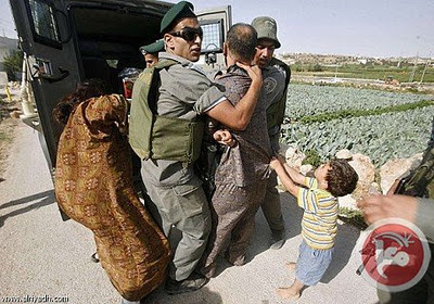 palestinian_kid_begs_israeli_soldiers_not_to_take_his_dad.jpg