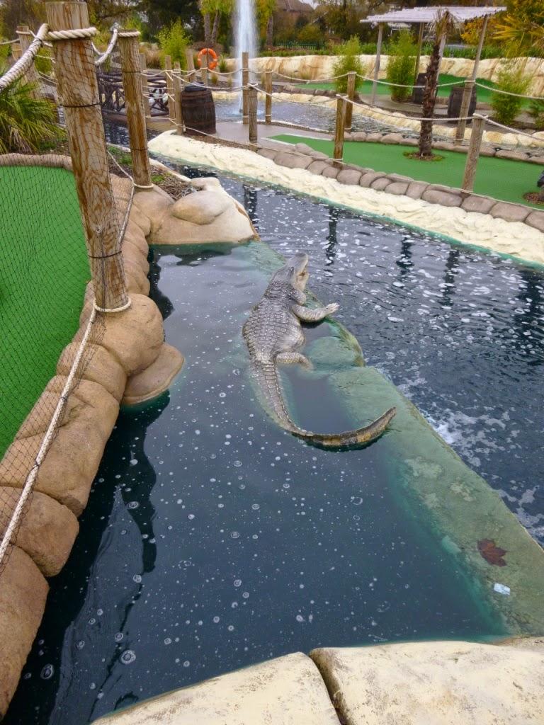 A crocodile at the Jungle Island Adventure Golf course at Horton Park Golf Club in Epsom, Surrey