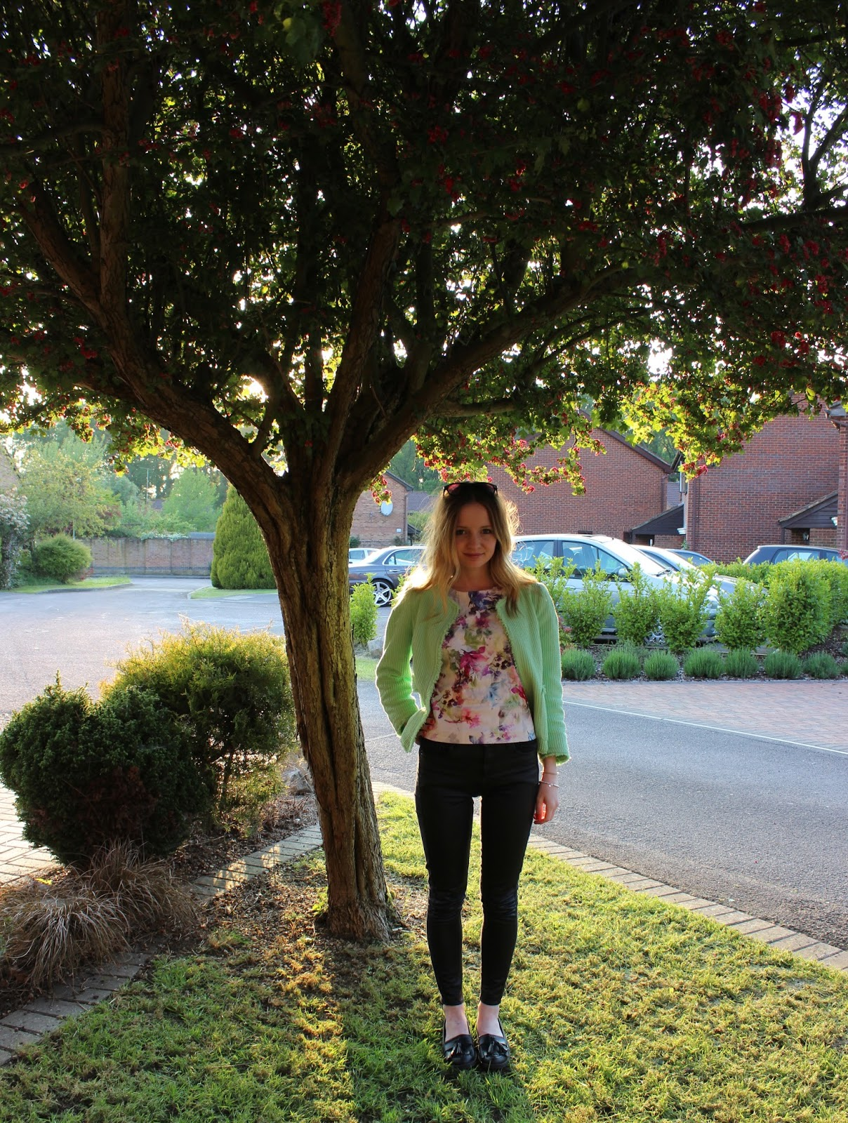 Green zara jacket, warehouse floral shell top and topshop leather fronted jeans