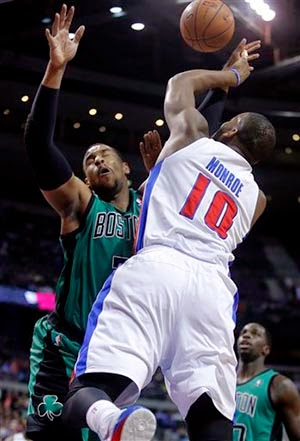 Detroit Pistons center Greg Monroe (10) is fouled by Boston Celtics forward Jared Sullinger while taking a shot.