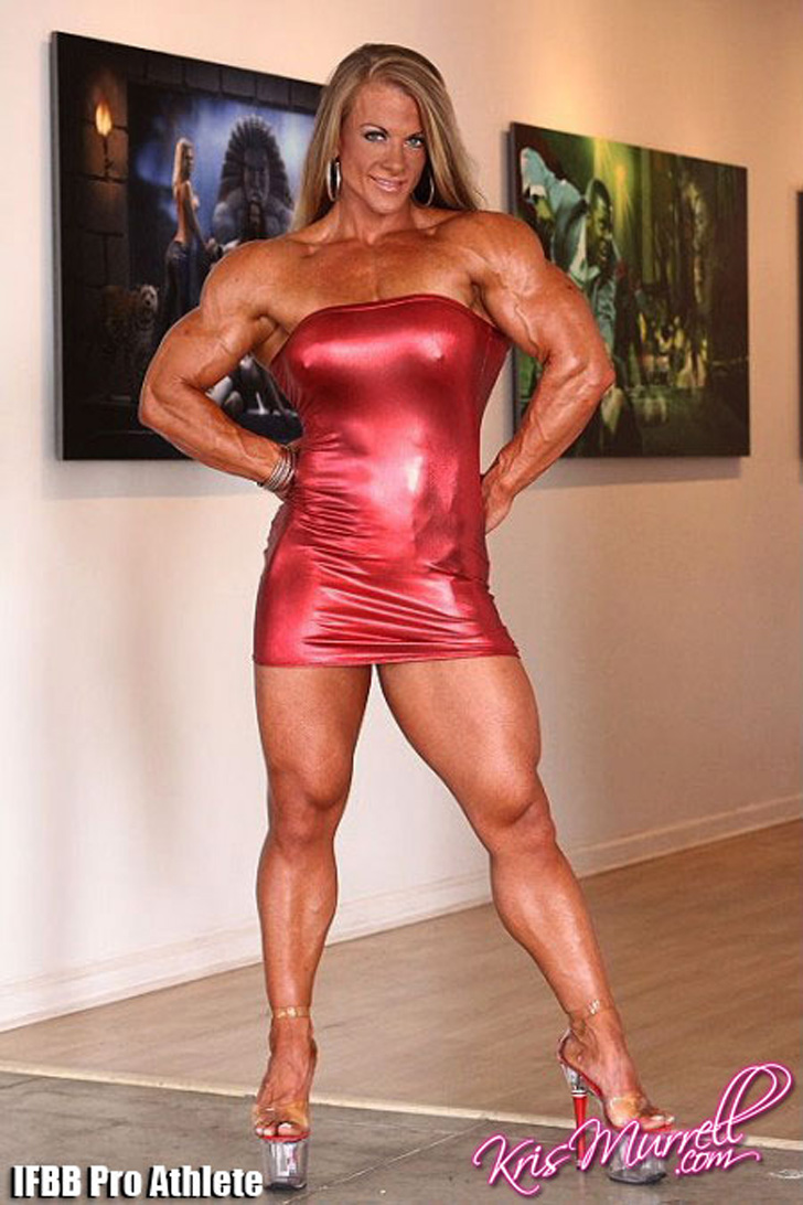 Kris Murrell Modeling Her Muscular Legs In A Red Dress And Heels